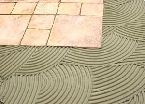 Фото - Інструкція, як правильно приготувати клей і приклеїти на нього плитку, а також огляд видів клею і рекомендації до вибору