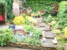 Фото - Як цікаво задіяти підпірні стінки в ландшафтному дизайні саду і присадибної ділянки