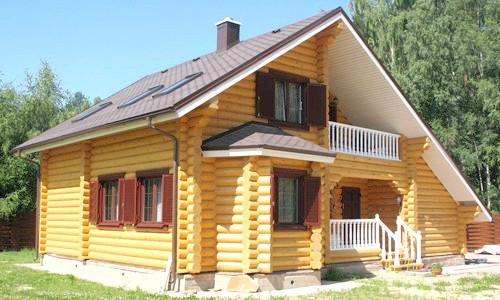 Фото - Як провести фарбування дерев'яного будинку?