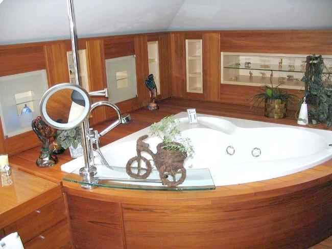 Фото - Ванна кімната в дерев'яному будинку: популярні способи обробки