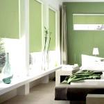 Сучасний інтер'єр спальні в зеленому кольорі