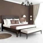 Спальня в шоколадному і білому кольорах