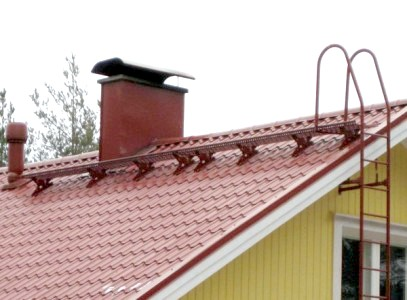 Фото - Перехідні містки для даху: безпека ремонтних робіт